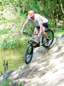 Photo of a man riding a mountain bike