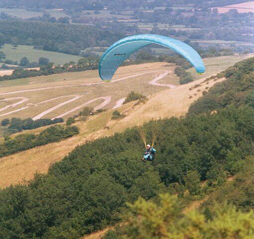 Photo of a paraglider in flight
