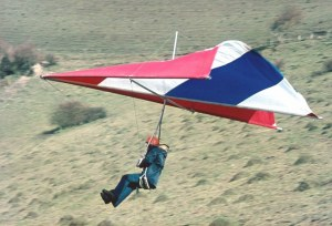 Photo of an early 1970s hang glider launching