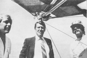 Photo of astronaut Wally Schirra with hang glider pilots at Torrey Pines