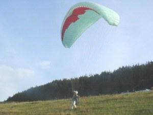 Photo of a paraglider about to launch