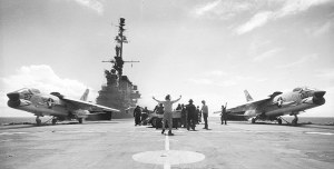 Photo of two F-8 jet fighters about to launch from an aircraft carrier