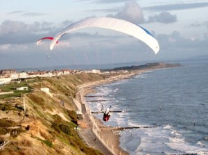 Aerial photo of paragliders flying the Bournemouth cliffs