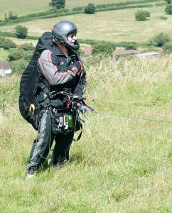 Photo of a paraglider pilot preparing to launch