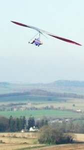 Photo of a hang glider above Dorset countryside
