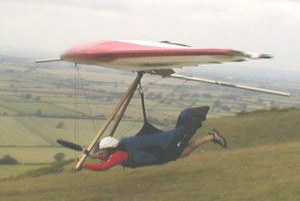 Photo of a rigid hang glider launching at Westbury