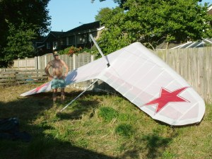 Photo of a hang glider rigged in a garden