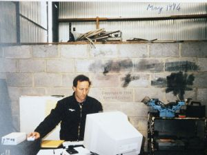 Computer programmer working in a barn in 1994