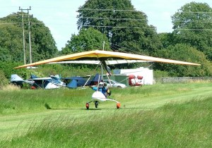 Photo of a flexwing powered ultralight taking off