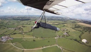 Wing-mounted camera view of hang glider in flight