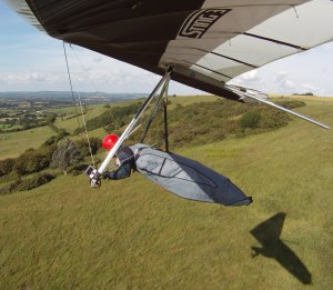 In-flight photo of hang glider launching