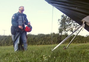 Hang glider pilot in landing field