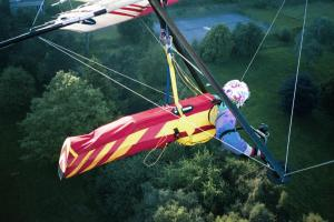 Wing-mounted camera view of hang glider on landing approach at Malvern in England