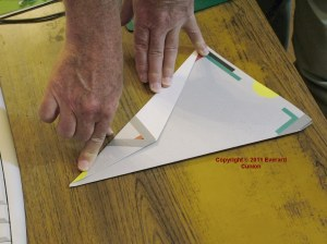 Photo of paper glider under construction