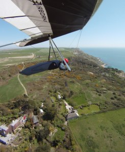 Wing-mounted camera photo of Everard Cunion flying a hang glider