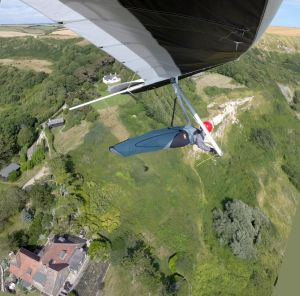 In-flight hang glider photo by wing-mounted camera