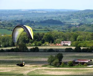 Paraglider flying at Monk's Down, England, in May 2015