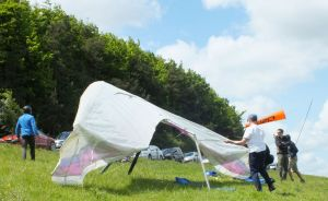 Hang glider being rigged on a hillside
