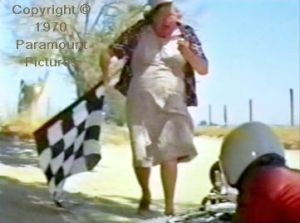Little's mother, stopwatch in one hand, chequered flag in the other