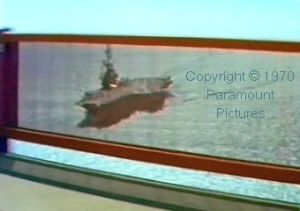 Aircraft carrier seen by Knox as he drives over San Francisco's Golden Gate bridge