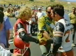 Fauss shakes hands with another competitor while real racers doubtless wonder why all the cameras and crew...
