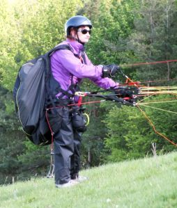 Paraglider pilot preparing to launch at Monk's Down