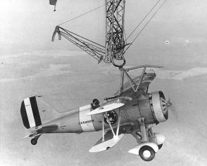 Curtiss F9C fighter attached to the helium-filled airship USS Macon in 1930. Wikipedia image.