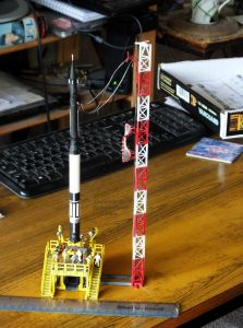 Scale model rocket, base, and tower
