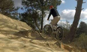 Tree root climb on a mountain bike