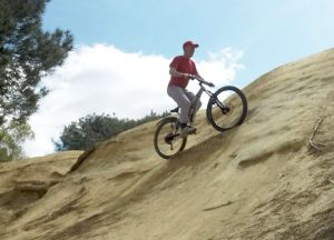 Mountain bike on up-hill camber