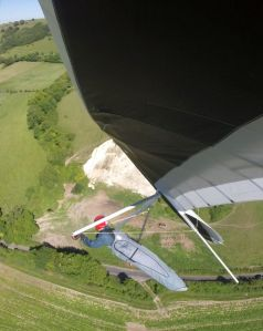 Hang glider banked over in a thermal close to the ground