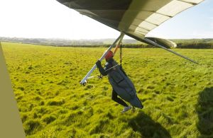 Hang glider rounding out at RAF Ringstead in 2017