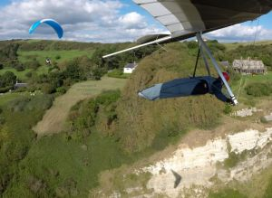 Hang glider and paraglider in flight at Ringstead