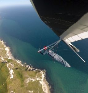 Hang glider flying over cliffs
