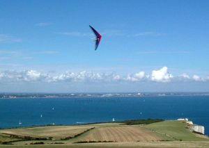 Phil 'ZZ' Smith flying a hang glider at Swanage by Gary D.
