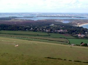 View of Poole Harbour looking back over the hang glider launch at Swanage