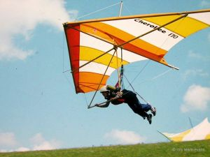 Hang glider launching from a hill