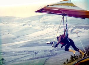 Roly launching a Birdman Cherokee hang glider at Kimmeridge in Dorset, England