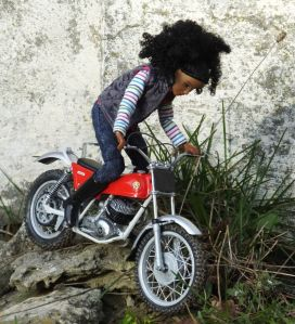 Breyer Nadia doll riding a 1/9th scale trials bike