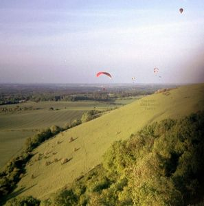 Paragliders and a balloon at Combe Gibbet in May or June, 2004