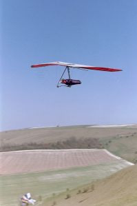Ron Smith flying a hang glider at Monk's Down in early 2003