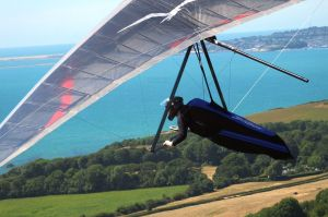 Hang glider seconds after launching at Ringstead, Dorset, England