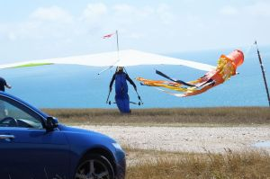 Avian Rio hang glider  being carried by its pilot