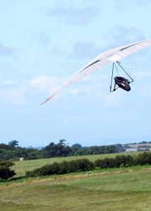 Hang glider soaring close to ridge height