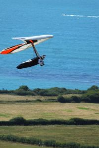Hang glider in flight on the coast of England