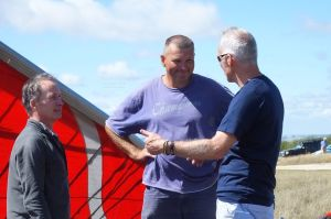 Hang glider pilots discussing their flights at Ringstead in Dorset, England