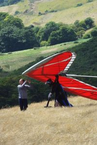 Carrying a hang glider to the launch area at Ringstead in Dorset, England