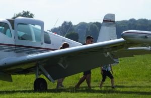 Pilot and passengers deplane from a Ryan Navion at Newton Peveril