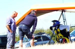 Hang glider pilot clipped in to his wing prior to launch