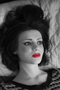 Anatomical doll in black and white with selective colour of lips